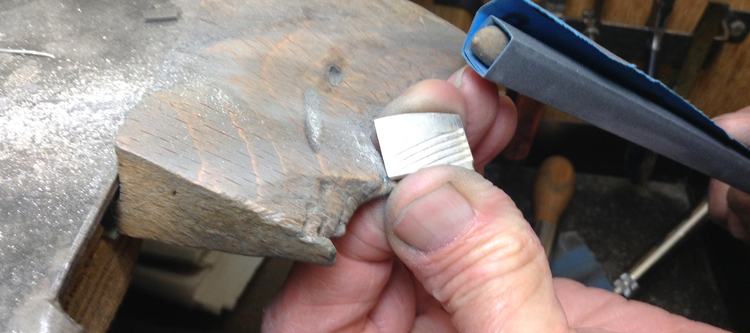 Paul buffing bespoke silver cufflinks