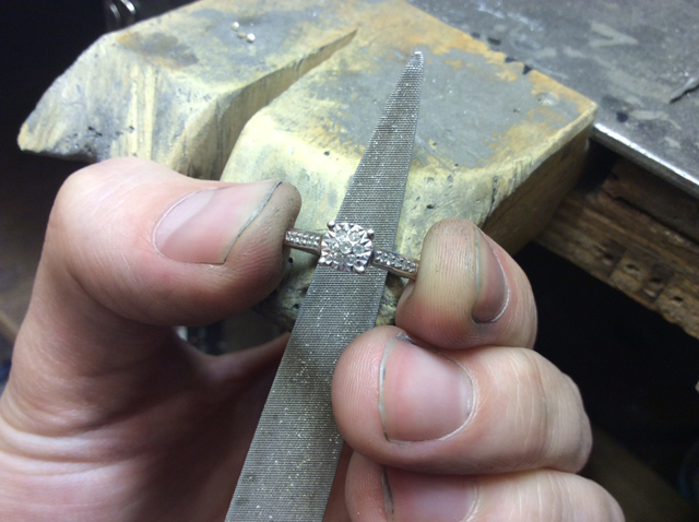 Filing a diamond ring
